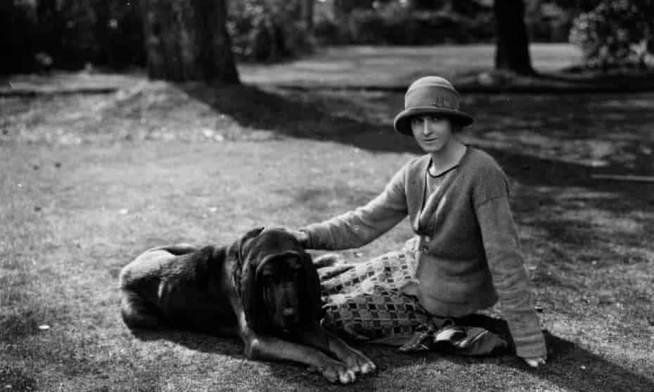 Rose MacaulayEnglish novelist, essayist and travel writer Rose Macaulay (1881 - 1958) sitting with bloodhound dog in the garden of Michael Sadleir (formerly Sadler). Original Publication: People Disc - HH0262 (Photo by Sasha/Getty Images)