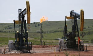 Oil pumps and natural gas burn off in Watford City in North Dakota as the US is currently the world's largest oil and gas producer.