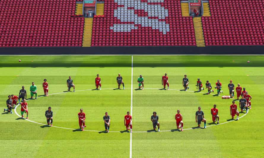 Liverpool players take a knee in memory of George Floyd at training on Monday.