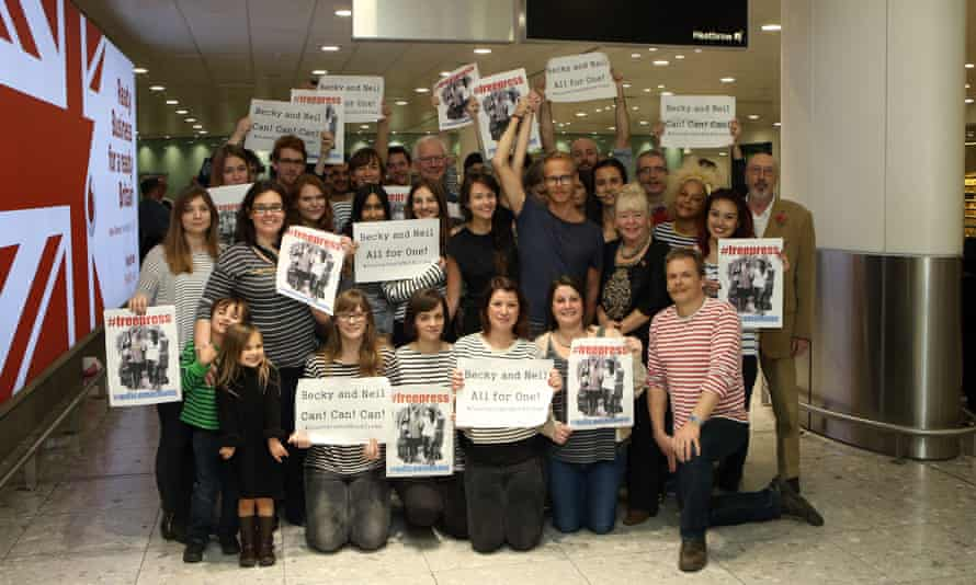 Prosser and Bonner surrounded by their welcoming committee at Heathrow.