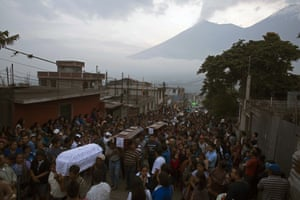 San Juan Alotenango, GuatemalaFunerals are held for seven of those killed when the Fuego volcano erupted. At least 99 are known to have died but the true number is likely to be much higher.