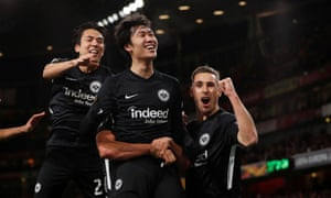Eintracht Frankfurt's Daichi Kamada celebrates with teammates after scoring their second goal.