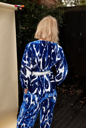 blue and white patterned top with long sleeves and trousers, white belt Marni