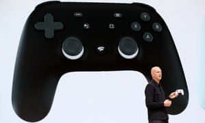 Google vice president and general manager Phil Harrison shows the new Stadia controller as he speaks during GDC
