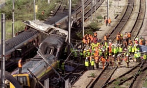 Rescue workers surround the wreckage of two trains after the crash near Paddington station on 5 October 1999