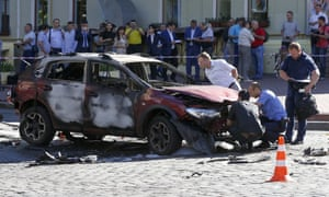 Forensic experts examine the the car in which Pavel Sheremet was killed in a bombing in Ukraine's capital, Kiev.