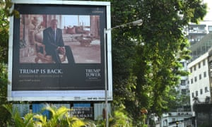 A billboard for Trump Tower Mumbai is seen next to a busy road in Mumbai in June.