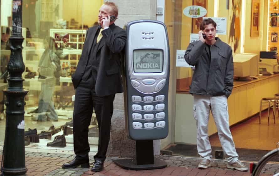 Men using mobile phones in Dusseldorf, Germany