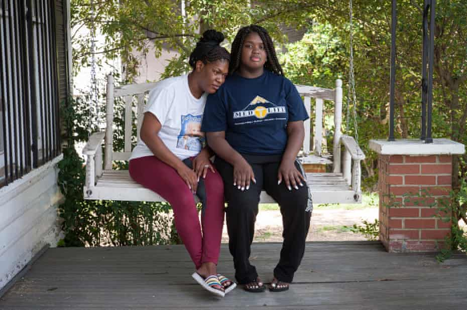 Monica McCaskill, left, and her daughter Kenya Johnson, at their home in Greenwood, Mississippi. They respectively lost their grandmother and great grandmother, Ethel Huntley, to Covid-19. Huntley lived in a nearby nursing home and the family allege failings in her primary care.
