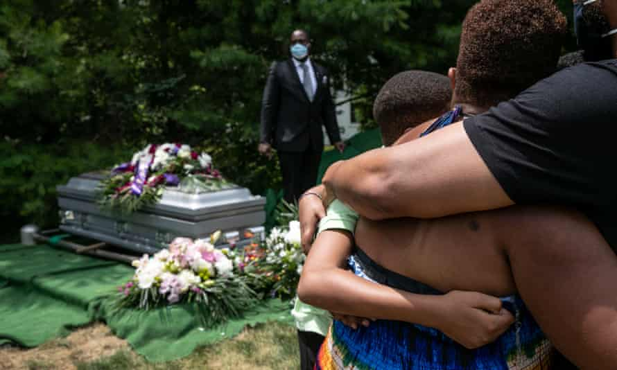 Family and friends mourn the death of Conrad Coleman Jr at his burial service on 3 July, 2020 in Rye, New York. Coleman, 39, died of Covid-19 in June, just over two months after his father also died of the disease.