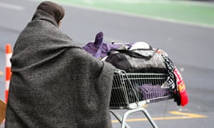 a homeless person with their things in a trolley