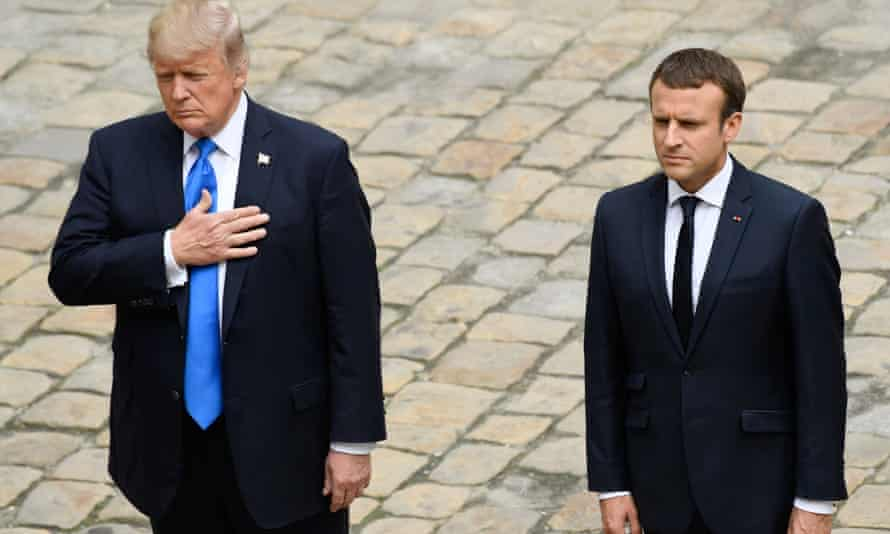 US President Donald Trump and French President Emmanuel Macron stand together during a welcome ceremony at Les Invalides in Paris