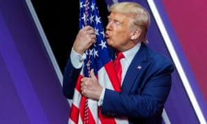 Donald Trump embraces the US flag after speaking to the 47th annual Conservative Political Action Conference.
