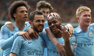 Raheem Sterling celebrates scoring Manchester City's fifth goal with his teammates in the FA Cup final win against Watford.
