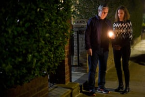 Labour leader Sir Keir Starmer and his wife Victoria hold a candle outside their home in north London during a doorstep vigil for Sarah Everard.