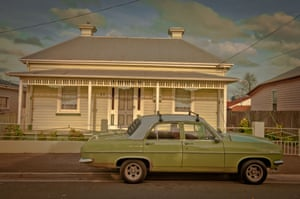 An old Holden car in front of a bungalow in Invermay, Tasmania