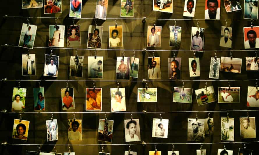 The pictures of dead people donated by survivors are installed on a wall inside the Gisozi memorial in Kigali April 2004.