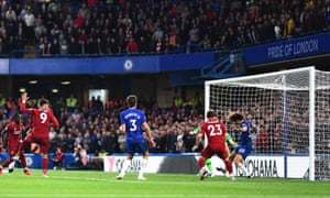 Roberto Firmino of Liverpool has a header cleared off the line by David Luiz of Chelsea.