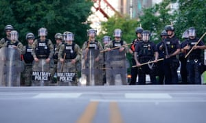 Law enforcement block a street during a protest in Louisville, Kentucky. Officers involved in the shooting failed to active body cameras.