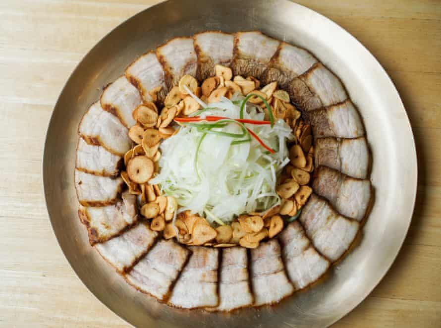 A plate of bo ssam, Korean-style boiled pork belly.