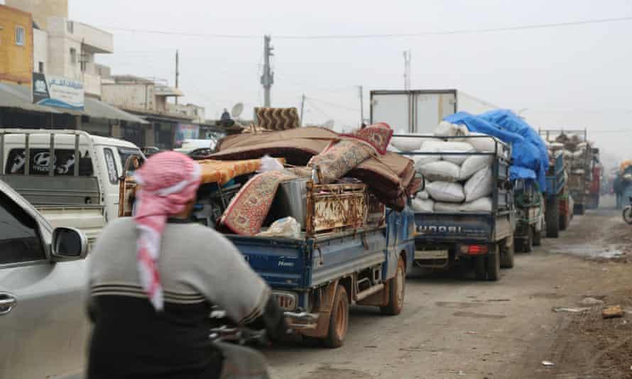 Trucks carry the belongings of people leaving Maarat al-Numan on Tuesday.