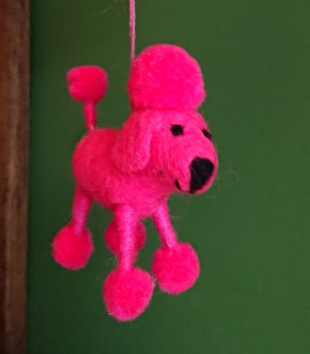 A pink poodle Christmas tree decorations.