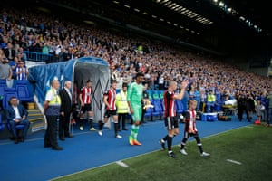 Paul Coutts leads out United before kick-off.