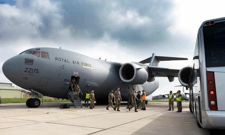 UK military personnel departing from an RAF C-17 aircraft at RAF Brize Norton, Oxfordshire, after the Kabul evacuation.