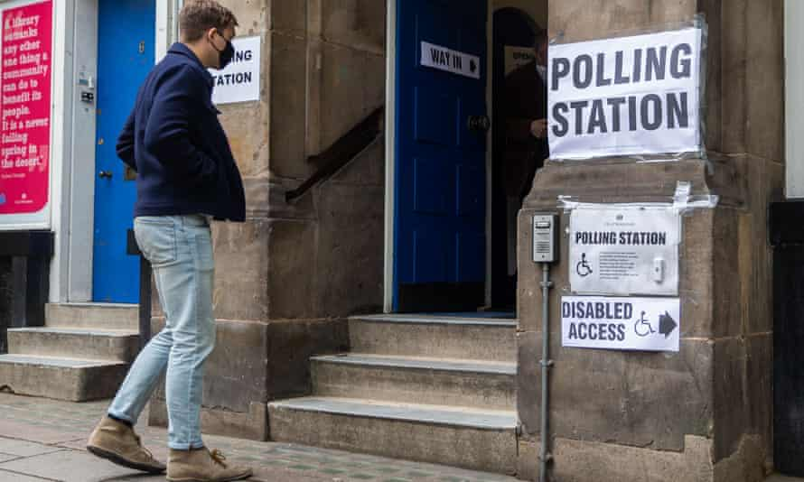 A voter preparing to enter a polling station in London