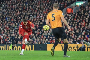 Roberto Firmino of Liverpool watches his shot go over the bar.
