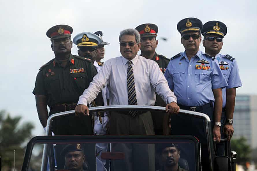 Gotabaya Rajapaksa, then defence minister, centre, rides in a Victory Day parade rehearsal in Colombo in 2013, marking the fourth anniversary of the defeat of the Tamil Tigers.