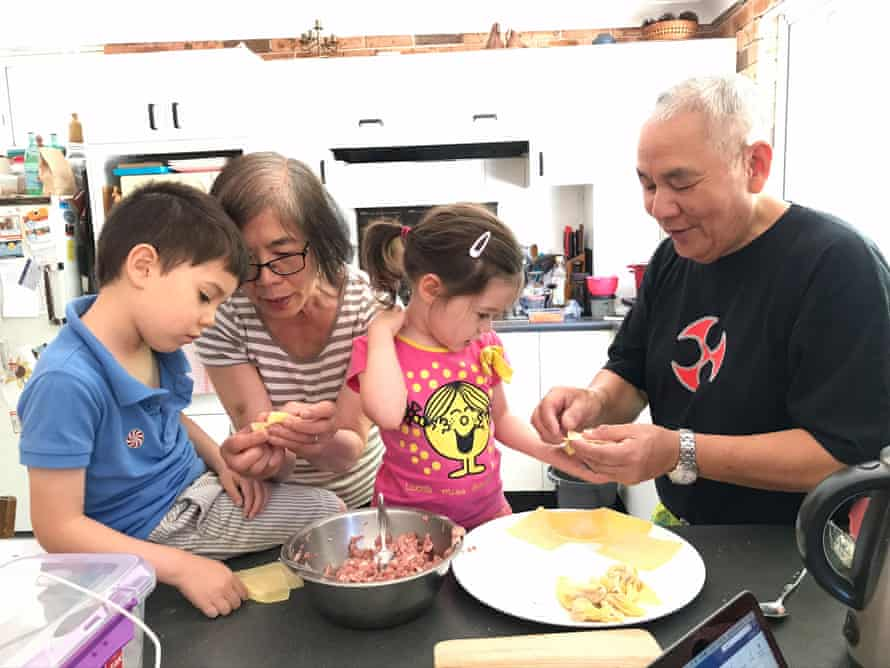 Katrina's children cooking with their grandparents.