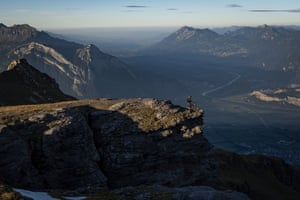 Wangs, Switzerland: A mountain biker peers down the Rhine valley