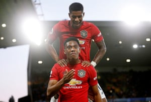 Martial celebrates with Marcus Rashford.