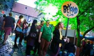 Fringe audiences queue for the Beyond venue at Pleasance Courtyard.