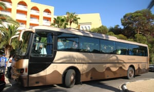 Tourists board a bus after the hotel attack in Sousse, Tunisia.