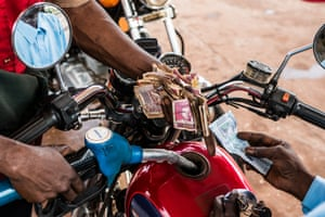 Motorcycles are filled up in Kamsar, Guinea.