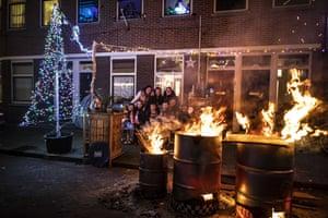 Revellers celebrate in the Scheveningen, in the Netherlands where fireworks were banned