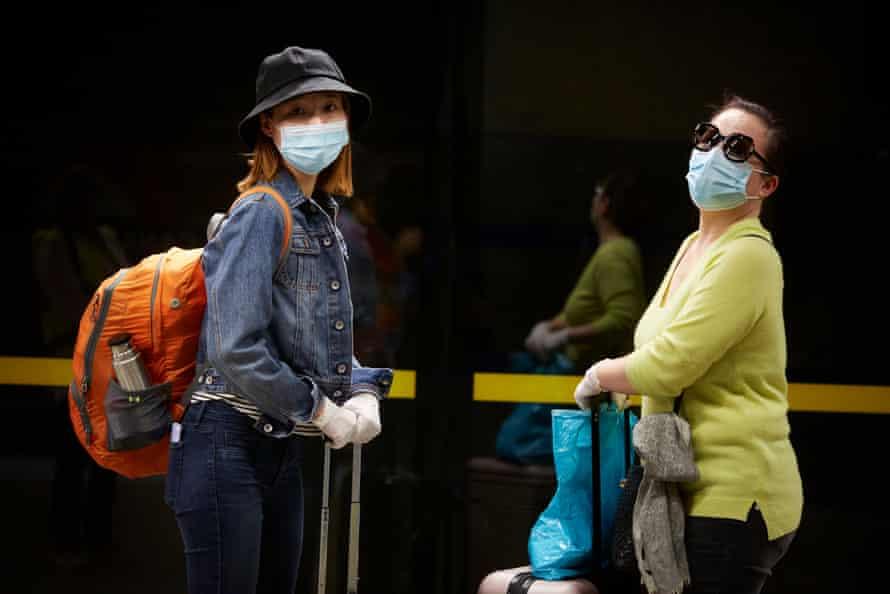 Roxy Yang, 28 and Sue Yang, 54 at Canary Wharf Station