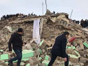 Crews and locals conduct search and rescue works at the site of collapsed buildings after a 5.9  magnitude earthquake struck near the border with Iran
