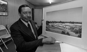 Floyd McKissick poses with an architect's rendering of the Soultech 1 industrial park.