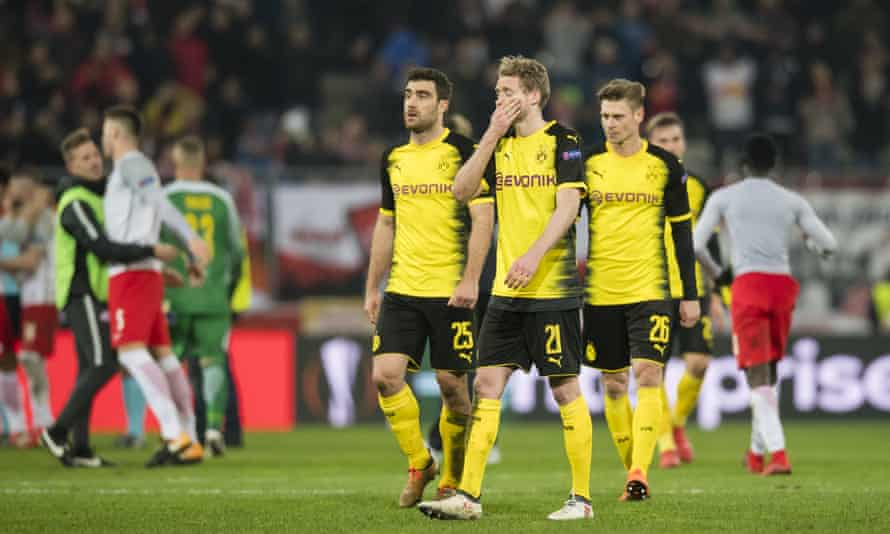 The Borussia Dortmund players look dejected after their Europa League exit as the Red Bull Salzburg players celebrate.