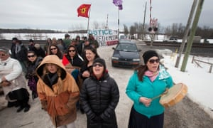 First Nations women form a blockade in Ontario on 19 March 2014 to call attention to missing and murdered indigenous and aboriginal women.