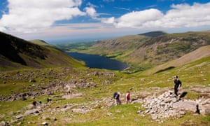 Campaigners say using tarmac would compromise the historic and rural character of Lake District's path.