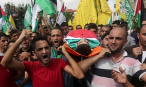 Mourners carry the body of Huzeifa Othman Suleiman, an 18-year-old Palestinian man who was shot dead by Israeli soldiers during clashes the previous day in Tulkarem, during his funeral in the West Bank village of Bala.