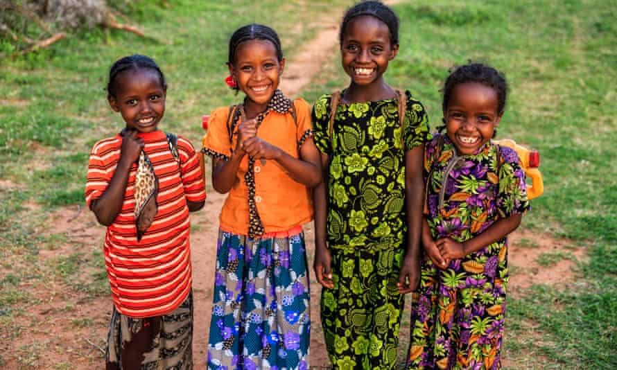 Girls from Borana tribe carrying water to their village in Ethiopia