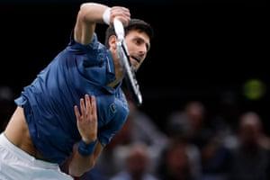 Djokovic gets the match underway.
