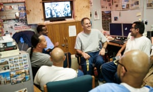 Prisoners at San Quention watch the Super Bowl 50 on 7 February 2016 Arnulfo T Garcia (center), Miguel Quezada (right) and others watching Super Bowl in San Quentin News office