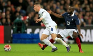 England's Ross Barkley (left) and France's Lassana Diarra in action.