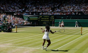 Serena Williams fires a return back to Garbiñe Muguruza in the women's singles final at Wimbledon.
